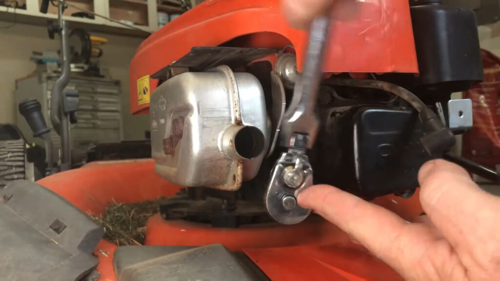 ratchet with the 5/8 spark plug socket for the lawn mower