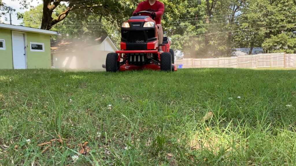 Cutting grass with Riding Lawn Mower